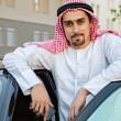 Arabian man Standing Next To Car — Stock Photo #50476393