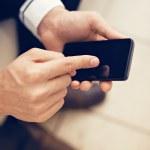 Usinessman using smart phone — Stock Photo #50477687