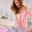 Woman Folding Clothes On Ironing Board — Stock Photo #50486099