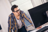 Graphic designer working in office — Stock Photo