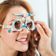 Постер, плакат: Optometrist Giving Woman Eye Examination