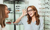 Woman With Friend Examining Eyeglasses — Stock Photo
