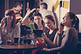 Young Cheerful Friends In Pub — Stock Photo