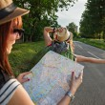 Tourist Girls Hitchhiking On Road — Stock Photo #50503373