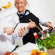 Mature couple cooking together — Stock Photo #50504527