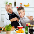 Mature couple cooking together — Stock Photo #50504553