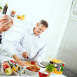 Mature couple cooking together — Stock Photo