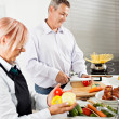 Mature couple cooking together — Stock Photo #50504581