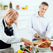 Mature couple cooking together — Stock Photo #50504583