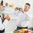 Mature couple cooking together — Stock Photo #50504593