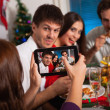Friends taking picture on Christmas eve — Stock Photo
