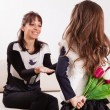Girl giving her mother flowers — Stock Photo #50507629