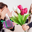 Girl giving her mother flowers — Stock Photo #50507647