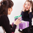 Mother giving daughter surprise gift — Stock Photo #50509277