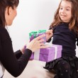 Mother giving daughter surprise gift — Stock Photo #50509407