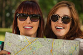 Tourist Girls In Nature Browse Map — Stock Photo