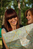 Tourist Girls In Nature Browsing Map — Stock Photo