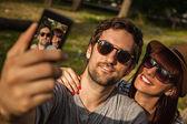 Smiling Couple Making Self Portrait — Zdjęcie stockowe