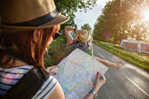Tourist Girls Hitchhiking On Road — Stock Photo