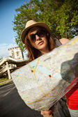Tourist Girl Browsing Map — Stock Photo