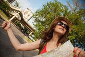 Tourist Girl Hitchhiking On Road — Stock Photo
