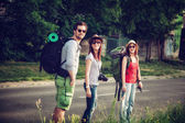 Tourists With Backpacks Walking On Road — Stock Photo