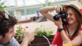 Girl Photographing Handsome Man — Zdjęcie stockowe