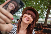 Smiling Woman Making Self Portrait — Stock Photo