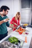 Man is taking photo of wife cooking — Zdjęcie stockowe
