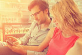 Couple in cafe using smart phone — Stock Photo