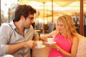 Couple in cafe having coffee — Stock Photo