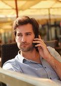 Man talking on mobile phone — Stock Photo