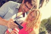 Couple using smart phone — Stock Photo