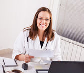 Female doctor working in office — ストック写真