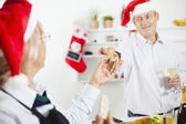 Happy couple baking christmas cookies — Stock Photo