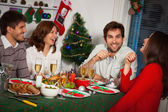 People gather together for Christmas dinner — Stock Photo