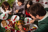 People gather together for Christmas dinner — Stock fotografie