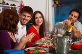 People gather together for Christmas dinner — Stockfoto