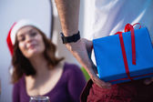 Man giving Christmas present to girlfriend — Stock Photo