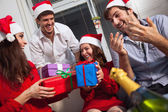 Friends exchanging presents at Christmas — Stock Photo