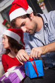 Man opening Christmas present — Stock Photo