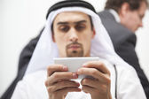 Middle Eastern businessman using smartphone — Stock Photo