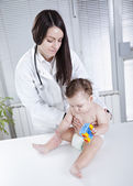 Baby and doctor — Stock Photo