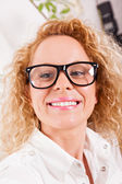 Blond woman with glasses — Stock Photo