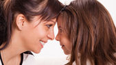 Mother and daughter embracing — Stock Photo