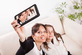Mother and daughter taking selfie — Stock Photo