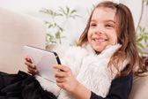 Little girl using digital tablet — Stock Photo