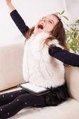 Happy girl using digital tablet — Stock Photo
