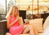 Woman enjoying sitting in cafe — Stock Photo