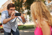 Man is taking photo of his girlfriend — Stock Photo